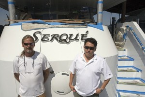 Engineering director Mike McCaskill and project manager Greg Cox pose with M/Y Serque. PHOTO BY CARLOS MILLER