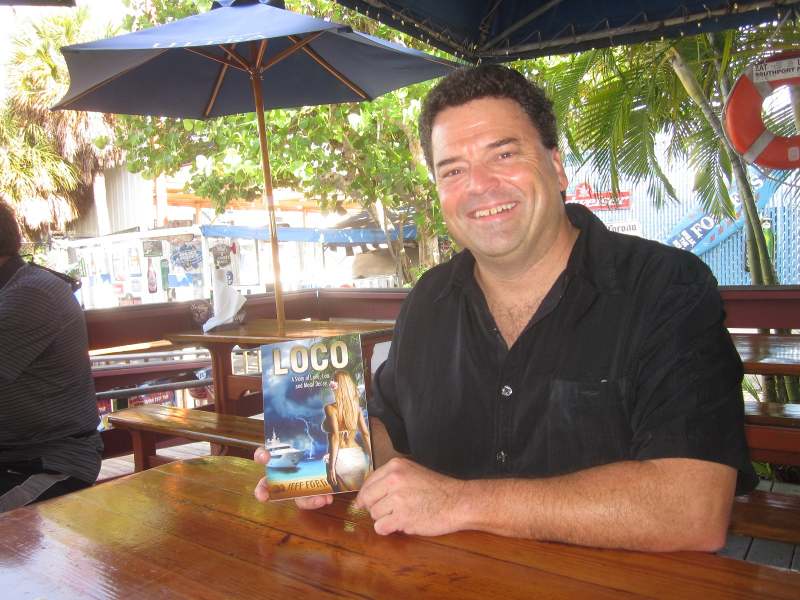 "Jeff Ford with his first novel, ""Loco: A story of love, loss and moral decay"". PHOTO BY DORIE COX"