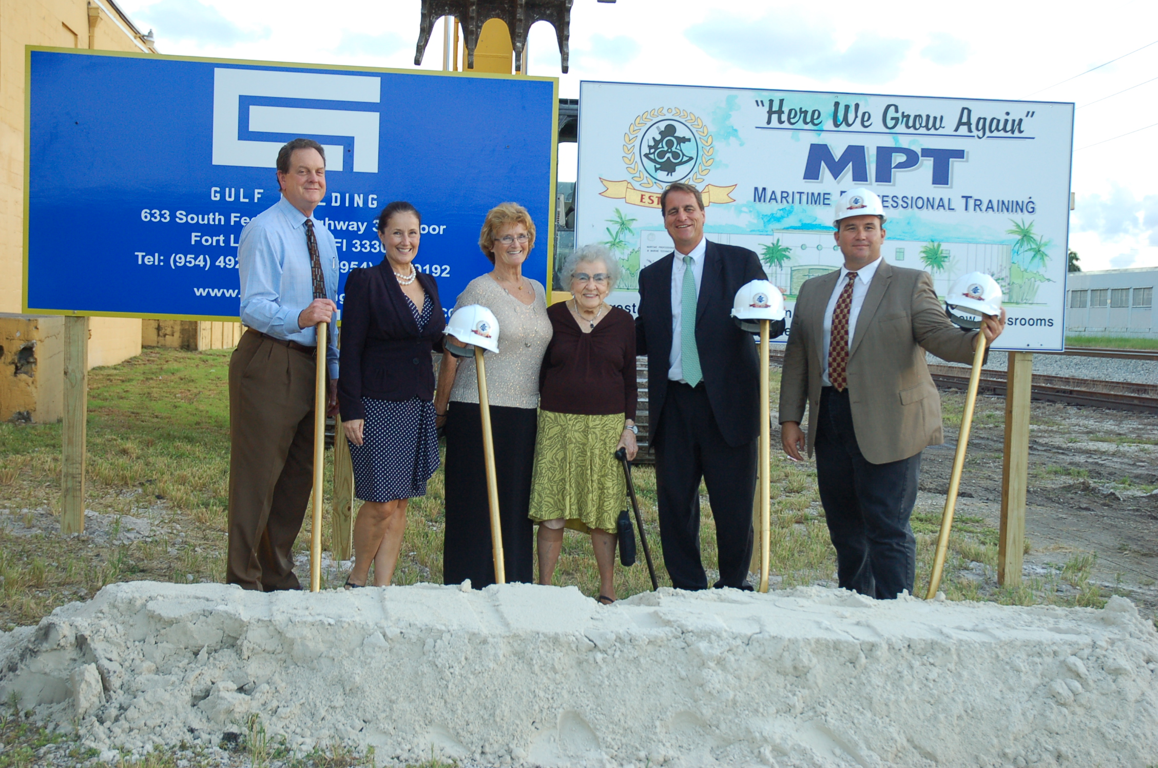 The Morley family and city dignitaries pose with Mae Simmons, center, a Ft. Lauderdale Realtor who helped MPT purchase its current location. School founder Beverly Morley, third from left, calls her the family's fairy godmother. LUCY REED