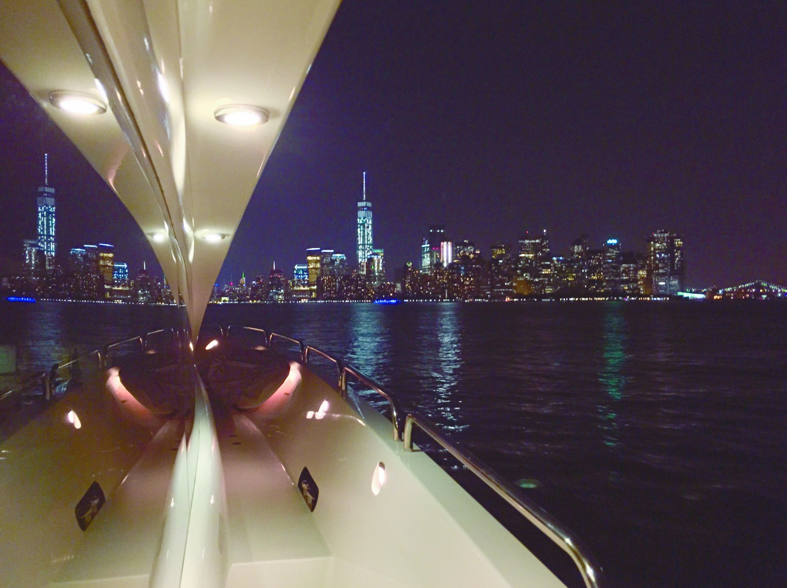 """Capt James Pat Riherd stepped away from the helm of the 116-foot Lazzara M/Y Quisisana this summer as they were leaving the Statue of Liberty, making way for Manhattan, to snap this shot on his iPhone 6.  """"I couldn't resist trying to capture the beauty of Manhattan at night,"""" he said.  Mission accomplished."""