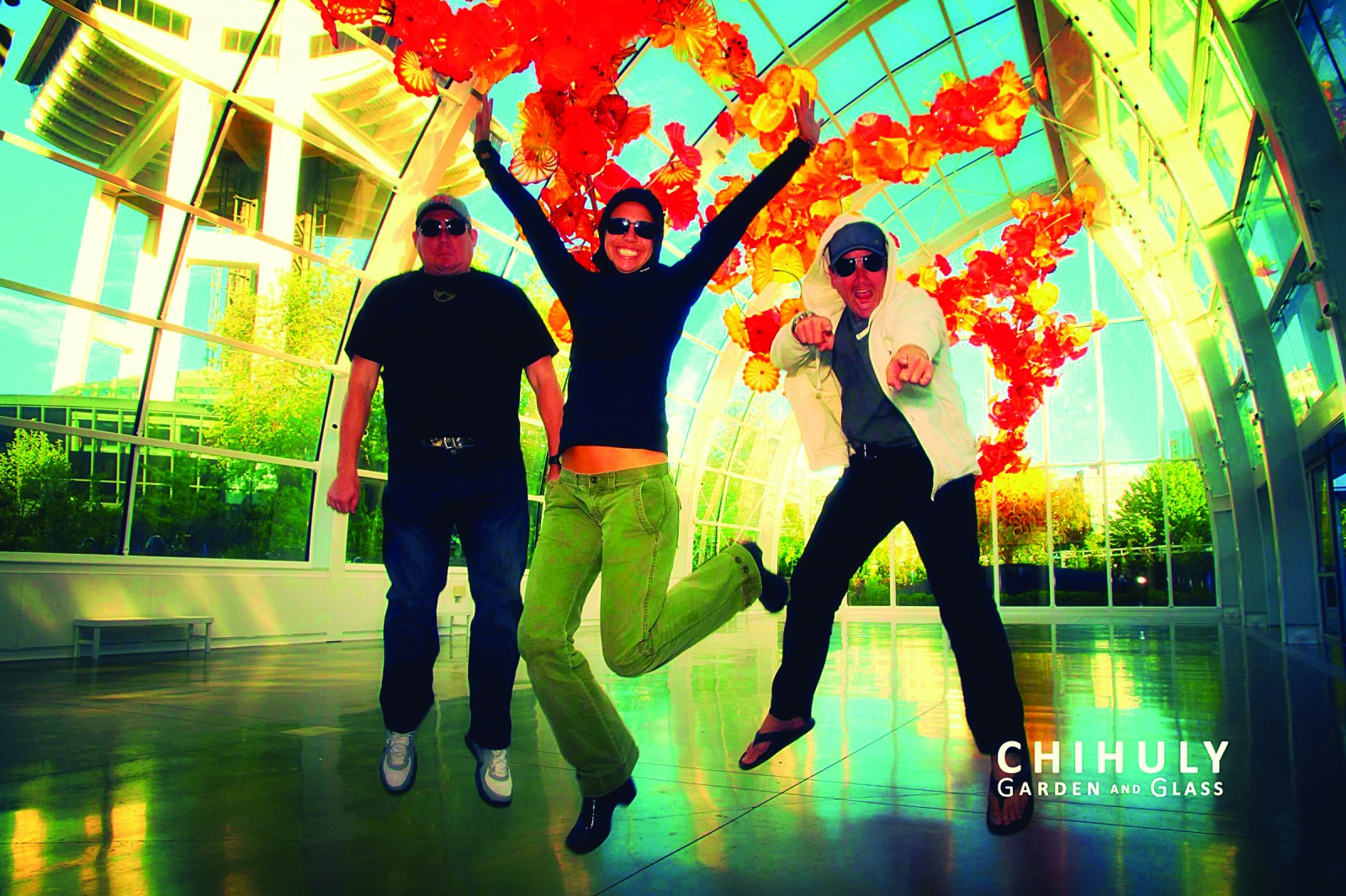 Jumpin' Jive, several of the crew of M/Y SOC had their photo taken at the Seattle Space Needle and Chihuly garden and glass exhibit in Seattle this summer. Photographed in mid-air, from the left, are Chef J Blevins, Stew Layla Jericho and First Mate Scott Fraser. The yacht was in Seattle to take in the sights during the yacht's voyage from Ft. Lauderdale to Alaska.