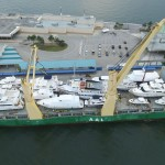 """Paul Haber of United Yacht Transport shared this photo of a load that left Port Everglades in Ft. Lauderdale early June. """"It was 24 boats on the massive M/V AAL Dalian going from Port Everglades to Victoria,"""" he said. """"The feature boats were the 112-foot custom, 93-foot Moonan, 80-foot Techomar, 80-foot Ocean Alexander and 76-foot Lazzara."""""""