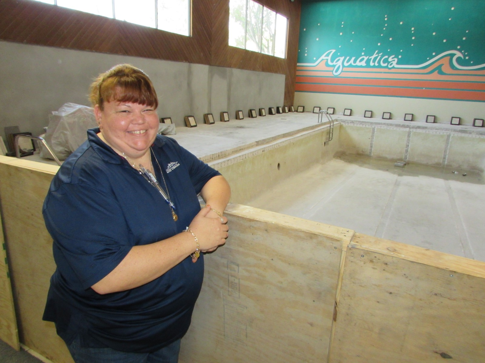 Office manager Charlotte Brillinger shows the indoor pool under construction at Yacht Chandlers' new location in Ft. Lauderdale this week. PHOTOS/DORIE COX