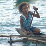 A young Papuan girl paddles her outrigger.PHOTO by SUE HACKING