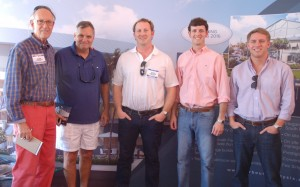 The Harbour Twenty-Six team at the boat show yesterday: broker Kit Denison, principal Marion Uter, and developers Nathan Cox, Thomas Gross and Will Lowery. Photo by Lucy Reed