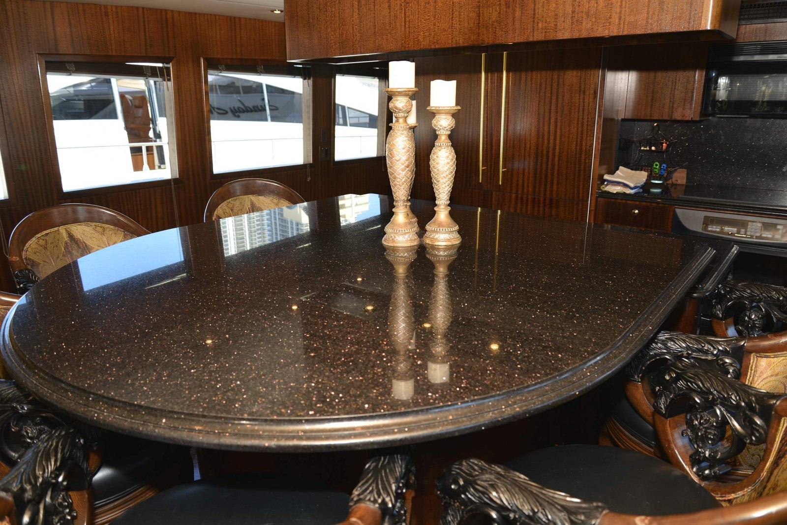 Nods to NASCAR on M/Y Sunday Money. The feel of the track is even evident with the semi-oval granite dinette, a nod to some of the famous NASCAR short tracks.