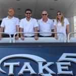 M/Y Take 5 crew at 2015 Miami Charter and Brokerage Show: Mate Thinus Opperman, Capt. Jono Bolton, Chef Shannon Ryan and Stew Anna Kozma.