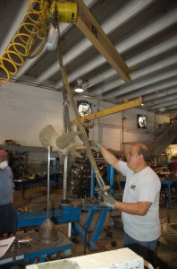 Weighing several hundred pounds, yacht propellers are moved with hydraulics and forklifts. PHOTOS BY DORIE COX
