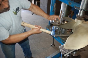 Work on damaged areas on a propeller at Frank & Jimmie's Propeller in Ft. Lauderdale last month. PHOTOS BY DORIE COX
