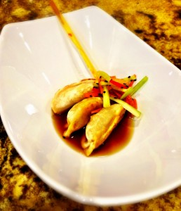 Chinese chicken potstickers in a soy lemongrass broth