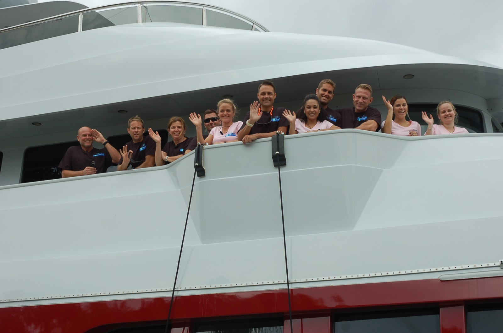 The excited and psyched crew of M/Y Qing as they prepare to set off on a three-year circumnavigation. Photo by Lucy Reed