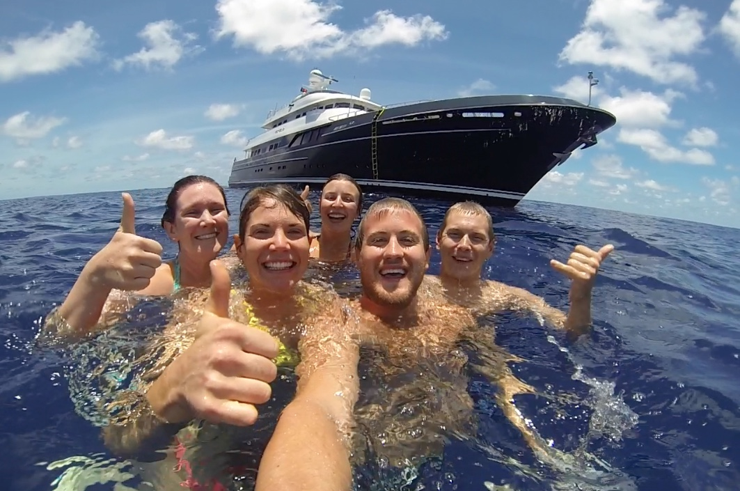 Some of the crew of M/Y Dorothea swim across the equator on their epic journey. From left, Stew Jessica Thomson, Chef Robin Wilson, Stew Phoebe Smart, Mate Thomas Price, and Eng. Aaron Drake.