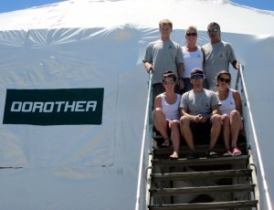 M/Y Dorothea III and her well-traveled crew -- from front, left: Stew Jessica Thomson, Mate Thomas Price, Deckhand Jamey Harrison, and back row: Eng. Aaron Drake, Mate Jenifer Rosser and Capt. John Crupi -- will spend the summer at Derecktor in Dania Beach, Fla.