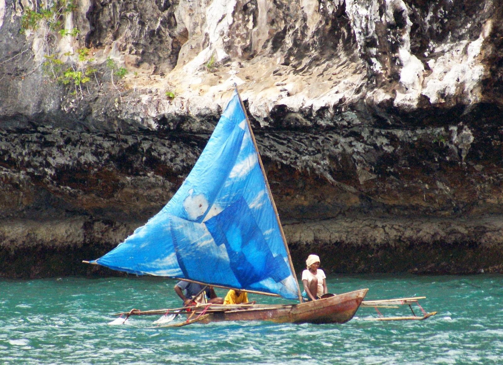 Outrigger canoes are still sailed between settlements in the calm waters of the straits. Photos from Sue Hacking (hackingfamily.com).