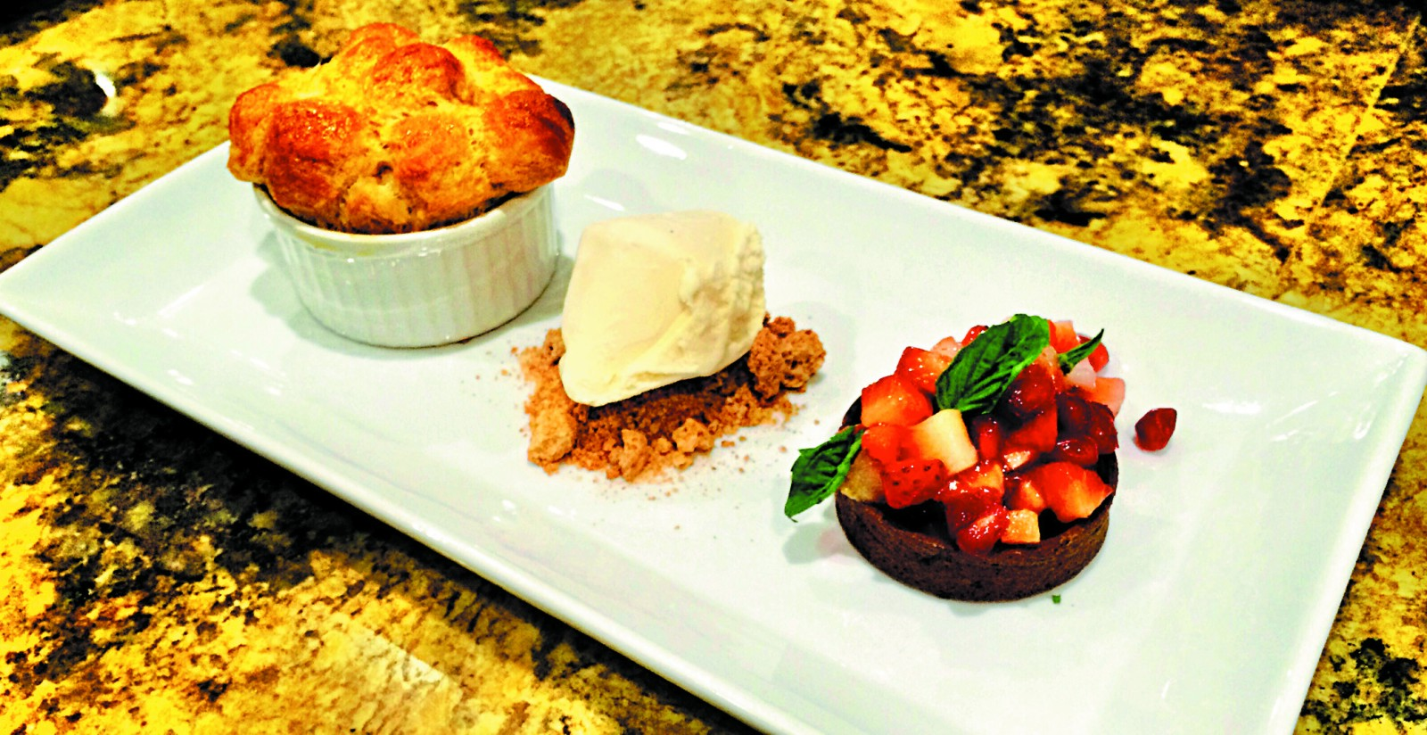 I served my cobbler with a vanilla bean ice cream, basil and strawberry salad-filled tartlet, and a gingersnap crumble. PHOTO BY MARK GODBEER