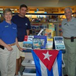 Bluewater Books and Charts owners Vivien Godfrey and John Mann, right, are taking a research trip to Cuba in search of update charts. Chart sales associate Alejandro Cepero, who grew up in Cuba, will help navigate and translate during the trip. PHOTO/LUCY REED