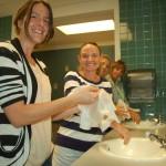 "Stew Jayne Thomas, Chief stew Michelle ""True"" Trueblood, Stew Sarah McFarlane and Chef Sherry Ellis demonstrate proper handwashing after a recent Food Safety course. PHOTO/DORIE COX"