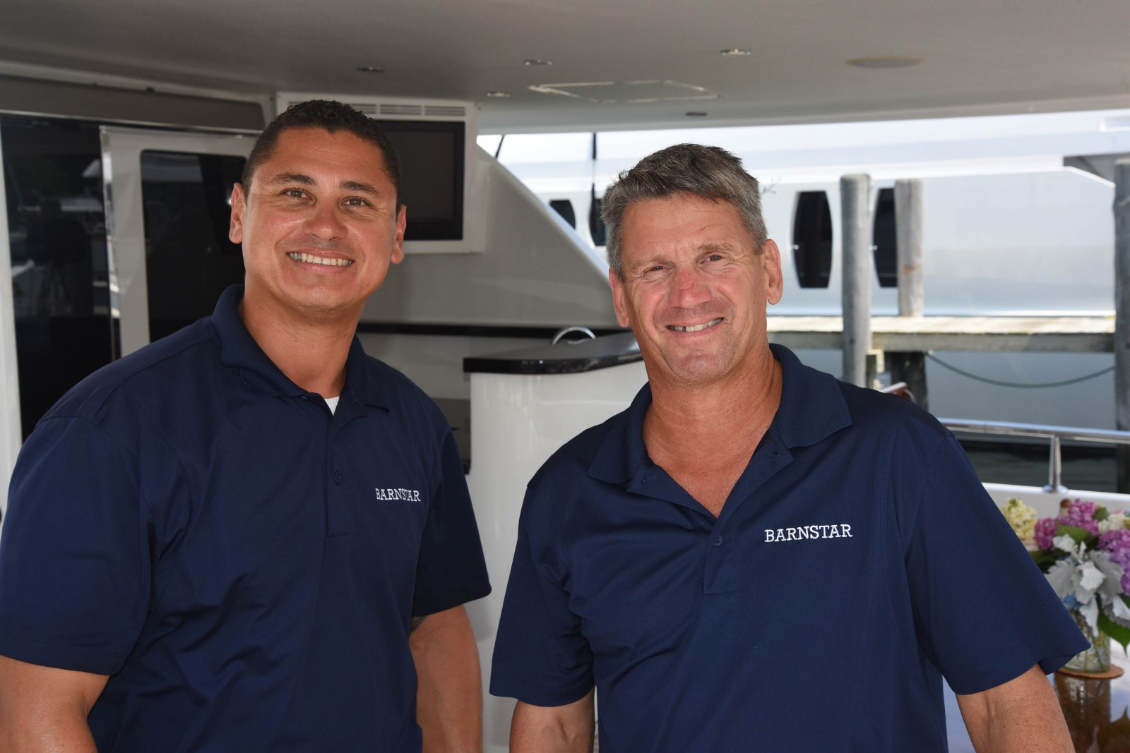 Mate Jose Saldago and Capt. John Weld prep M/Y Barnstar, an 83-foot Ocean Alexander, in Sag Harbor for her late summer cruise to New England. PHOTO/TOM SERIO