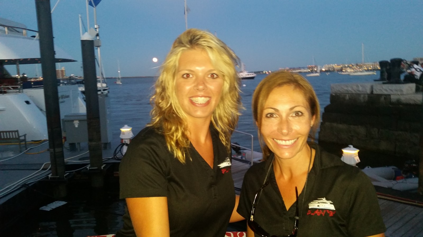 Taking a break from an owner's cruise, Deck/Stew Sterna Stockhoff and Chief Stew Heather Furlani of M/Y Plan B snapped this selfie at Waterboat Marina in Boston on the night of the blue moon, July 31. PHOTO/DECK/STEW STERNA STOCKHOFF
