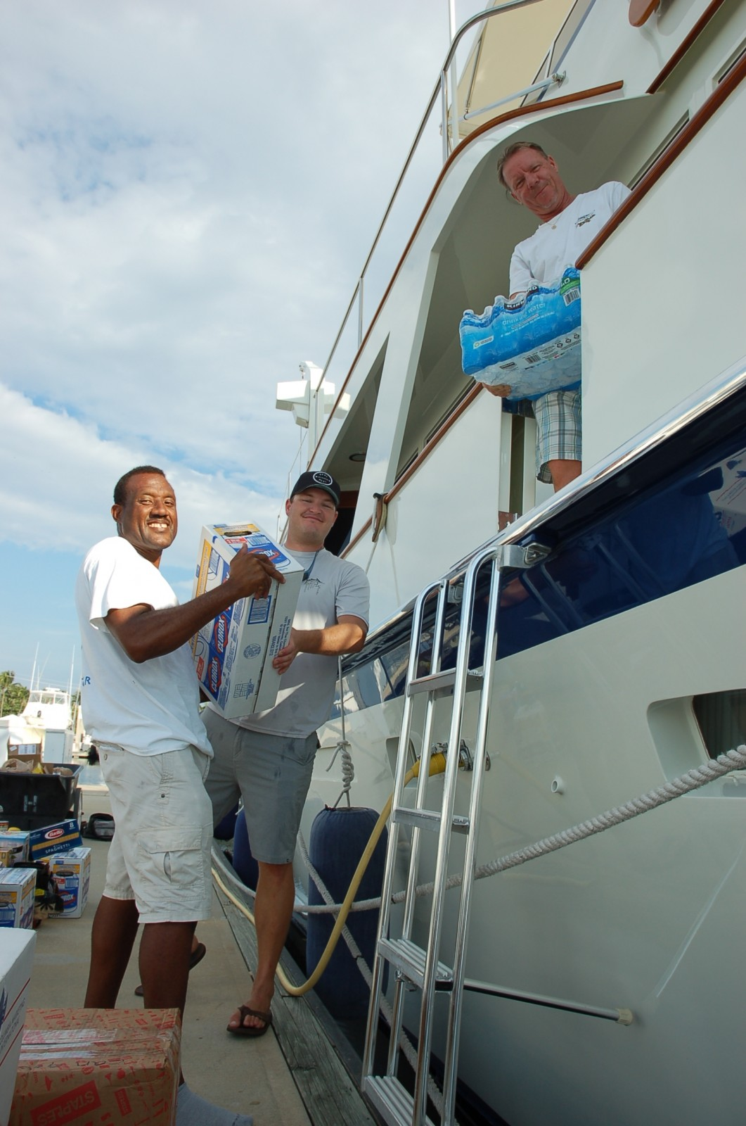 Wenzel Rolle, Jeremy Beller and Capt. Garry Schenck load donated supplies for Hurricane Joaquin relief effort in the Bahamas. (Oct. 9 at Bahia Mar Marina Ft. Lauderdale). PHOTO/DORIE COX