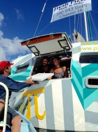 Sasha and Tara Bouis, last season, at work onboard Pizza Pi, a floating pizza boat run by her and husband, Sasha, in the U.S. Virgin Islands. PHOTO FROM WHERETHECOCONUTSGROW.COM