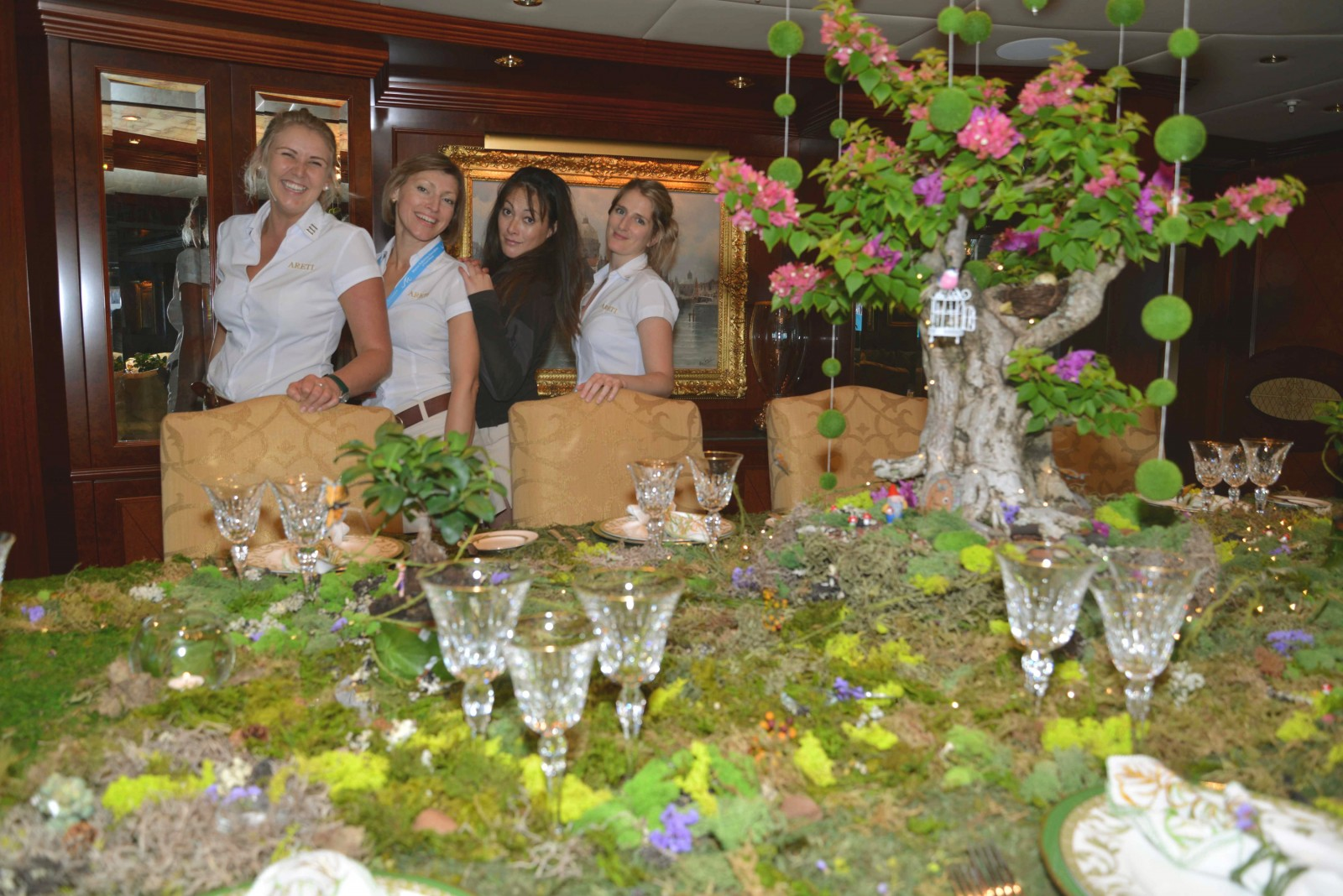 M/Y Areti – Chief Stew Bethany O'Hara, Purser Iryna Petrova, Sous Chef Steph Bidois and Stew Josie Piers created an Enchanted Forest setting, with a gnome, fairy garden, quail eggs, birds, and a 70 year old bonsai tree trunk.