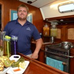 Capt. Matthias Bitterwolf shows the variety of flavored waters available in S/Y Antillean's galley. Antillean won CYBA's Designer Water Contest at the VICL's Fall Yacht Show in St. Thomas in November. PHOTO/DEAN BARNES