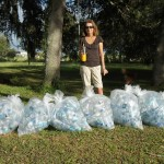 Campaign co-chairwoman Trish Cronan shows what a week of plastic water bottles looks like. PHOTO/DEAN BARNES