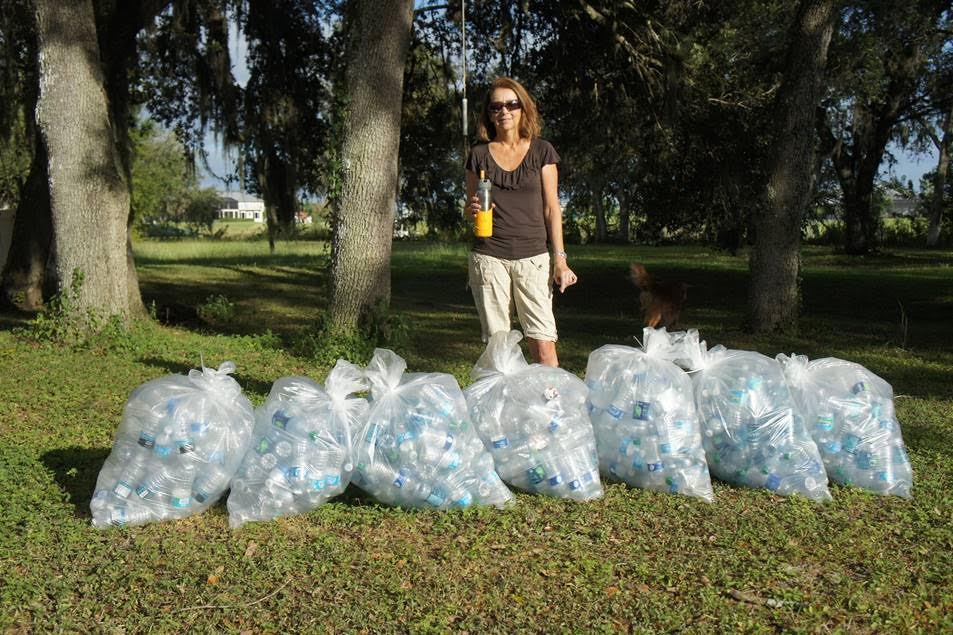 Campaign co-chairwoman Trish Cronan shows what a week of plastic water bottles looks like. PHOTO/DEAN BARNES