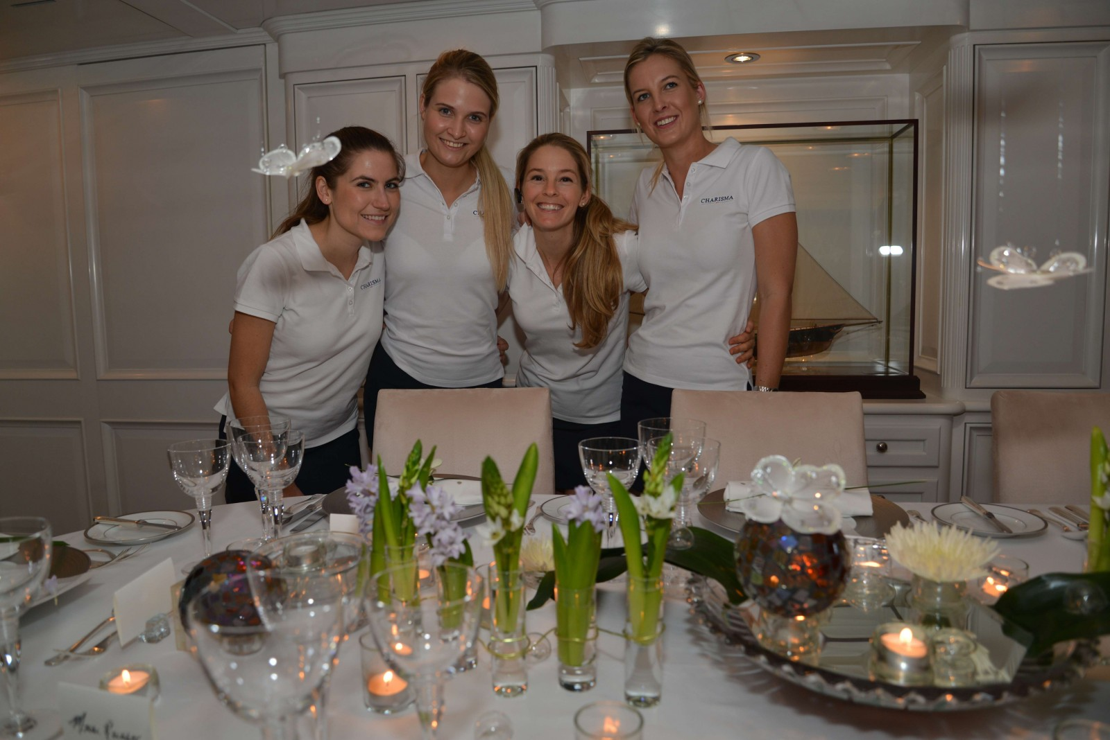 M/Y Charisma – The crew dreamed up a fantasy setting with flowers that show a transformation from caterpillar to butterfly, that appear to be flying over the table. Crew includes Stew Carmen Milton, Stew Kirsty Britz, Chief Stew Karine Lantra and Stew Michelle Adams.