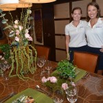 """M/Y Seven J's – Sporting a """"Never, Never Land"""" theme complete with crock-skin place mats, 2nd Stew Charlotte Fredette (L) and Chief Stew Bethany Hodnefield also had Tinkerbell cocktails and dragonfly napkin rings."""