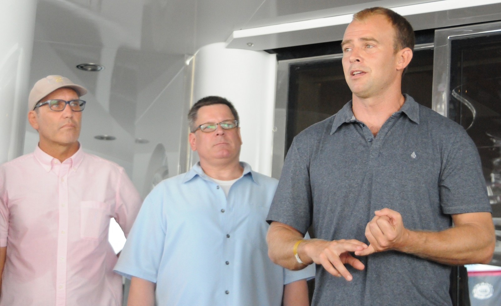 Former Navy Seal Grant Dawson, right, said he hopes to develop a program that will train more yacht crew on how to handle disaster emergencies during future relief efforts. Dawson is a leader with DART (Disaster Assistance Relief Team) and assists yacht crew as they engage in relief efforts such as the recent Vanuatu post Cyclone Pam in March 2015. From left are YachtAid Global Founder Mark Drewelow and LIFT Non-Profit Logistics Founder Michael Rettig who want to increase the list of superyachts that are willing to help out in emergency relief efforts as they happen.