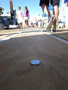 Who glued the coin on the dock at Fort Lauderdale International Boat Show?