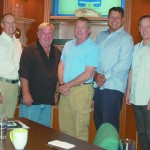 Attendees of The Triton's February From the Bridge luncheon were, from left, Mark Howard (freelance), Ned Stone (freelance/relief), Scott Rudisill (freelance), Mike French of M/Y No Comment, Herb Magney of M/Y Island Heiress, Mark O'Connell (freelance), and Oliver Dissman of M/Y La Tache. PHOTO/LUCY REED