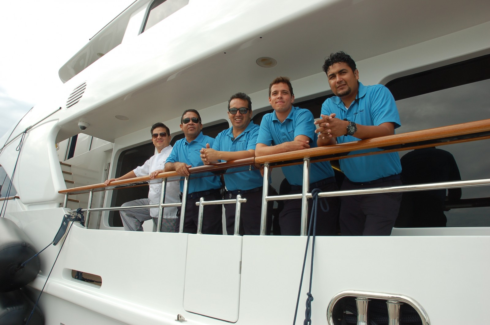 The crew of M/Y What a Country on deck for the official opening of Deep Harbour, the marina section of Watson Island's Island Garden on Jan. 8. From left, Chef Rodolfo Pichardo Montero, Antonio Cebrero, Capt. Agustin Hernandez, Elliot Castellanos and Luis Gonzalez. PHOTO DORIE COX