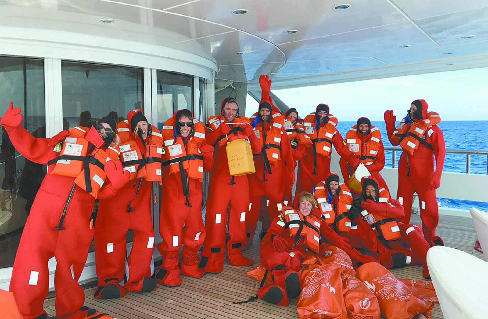 ALL HANDS ON DECK:The crew of the M/Y Lady Lola are bundled up in immersion suits during a drill enroute to La Paz. PHOTO/DAVID A. McDONALD