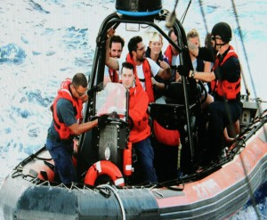 Crew off the M/Y Camarina Royale are transported by the USCG off a tanker which picked them up after sinking 70 miles off Cuba.