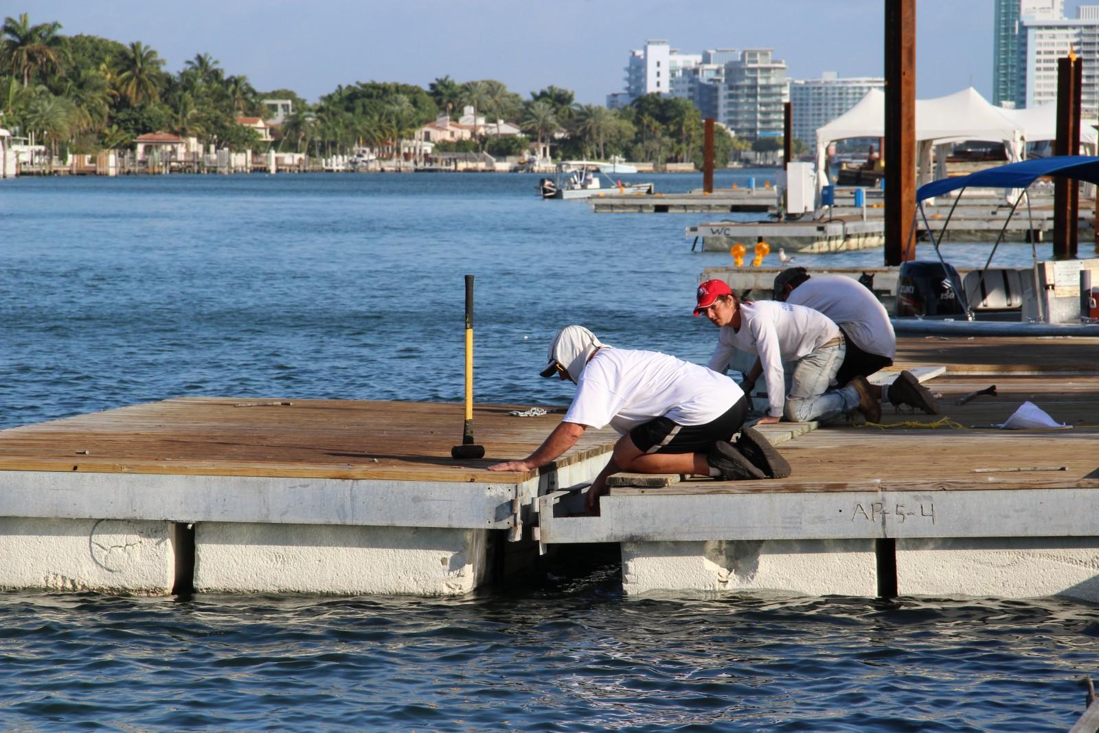 Show Management dock crew assemble 12,000 pieces of dock.