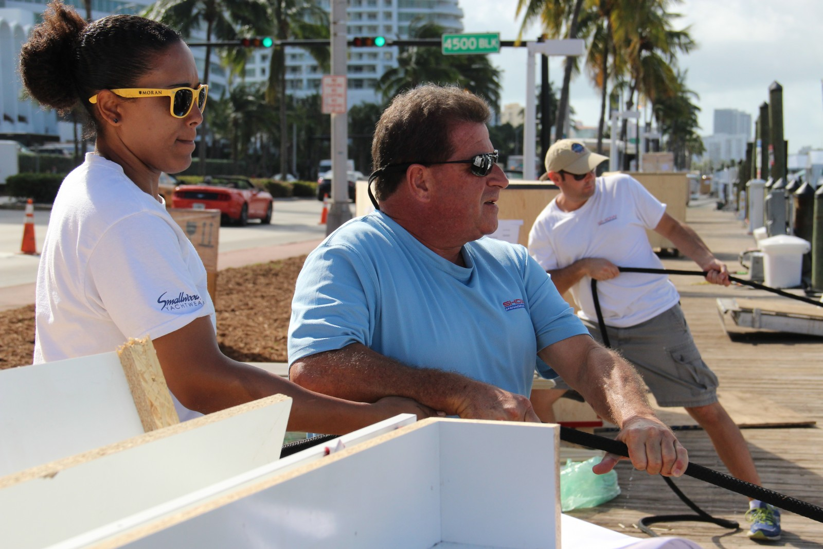 Show Management Coordinator John Nigro, center, and crew tie off a yacht.