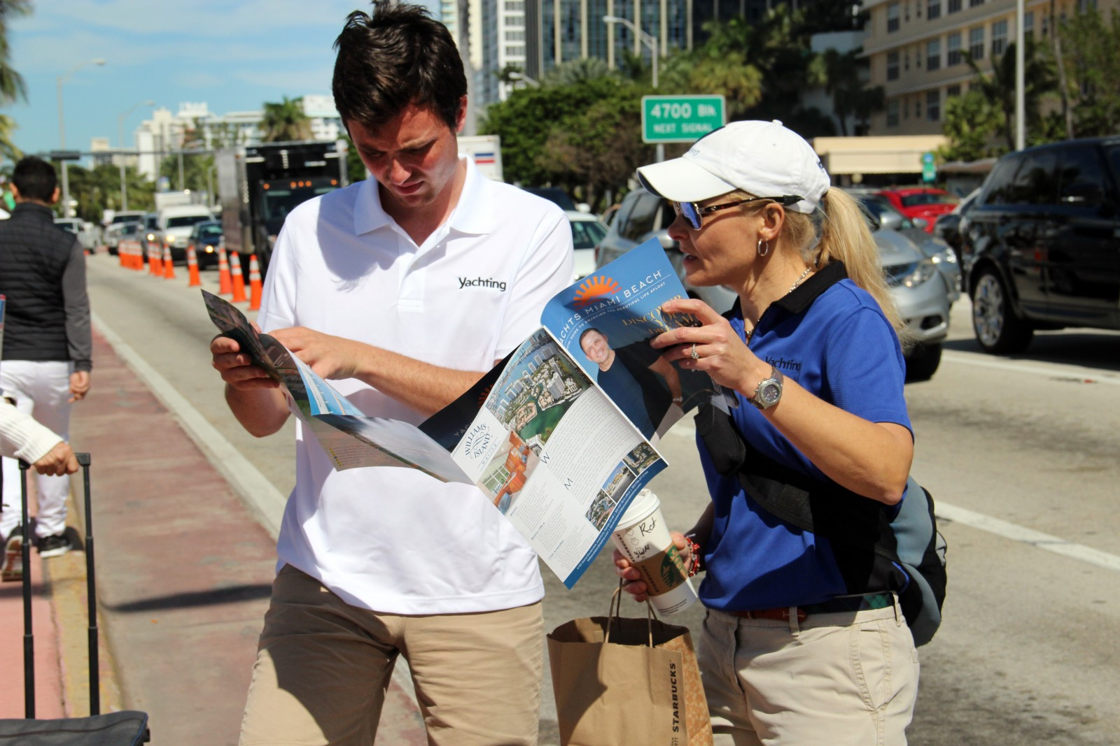 Yachts Miami Beach attendees try to orient themselves using a map of the event. Photo by Suzette Cook