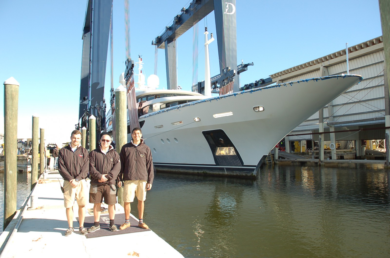 2nd Engineer Jakob Jensen, Chief Engineer Mads Petersen, 2nd Engineer Max Johnson wait to see if their work to lighten M/Y Meamina pays off. The lift this morning sets the record for heaviest yacht lifted at Derecktor in Ft. Lauderdale (Feb. 8). PHOTO/DORIE COX