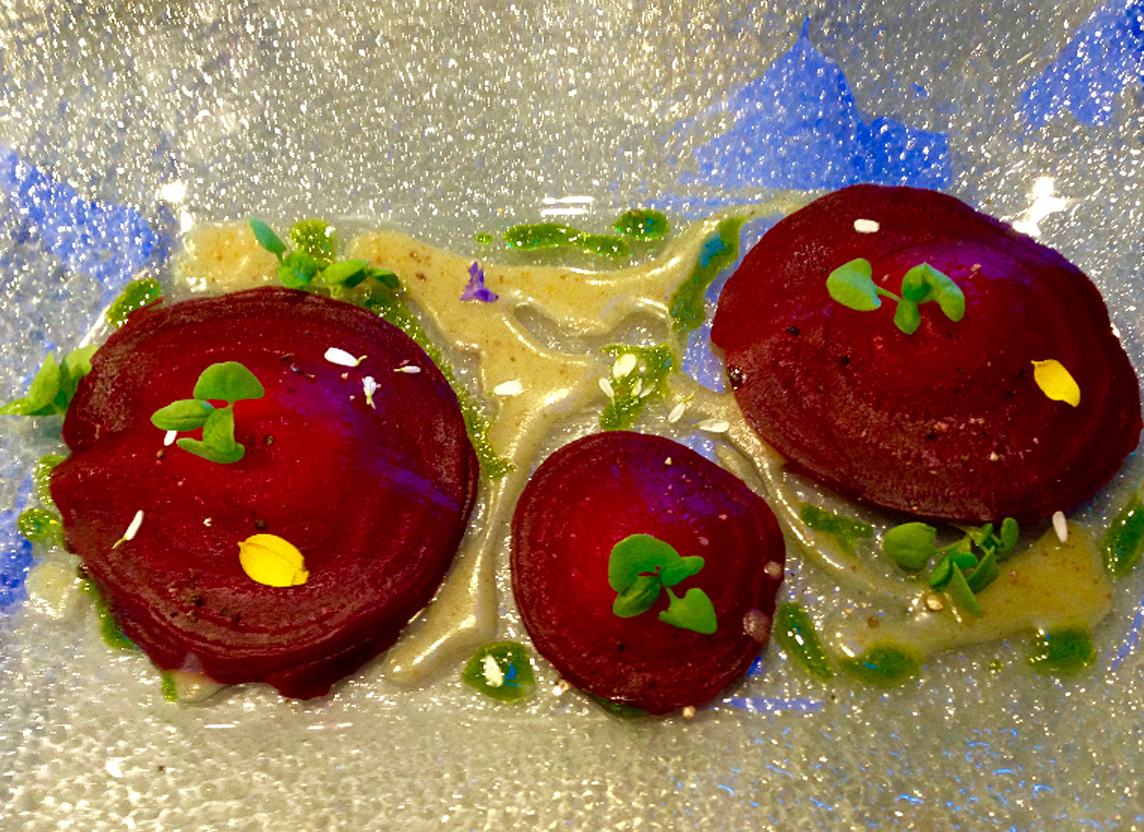 Whipped goat cheese, roasted lemon and cracked pepper filled beet ravioli. Top Shelf by Mark Godbeer