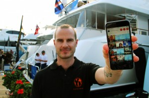 YachtNeeds co-founder Tony Stout shows off his latest app YachtChat designed for crew-to-crew communication and networking for jobs. Stout made a last-minute trip to the docks of Yachts Miami Beach boat show on Saturday (Feb. 13) to get app feedback from captains and crew.