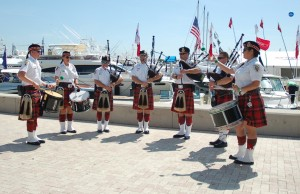 Pipe and Drum band takes to the docks at Palm Beach boat show