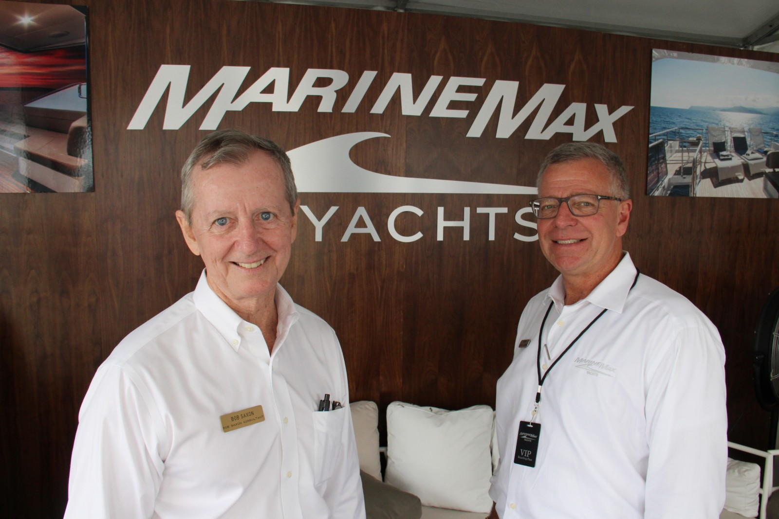 Bob Saxon, left, is welcomed aboard by Chuck Cashman of MarineMax. Photo by Suzette Cook