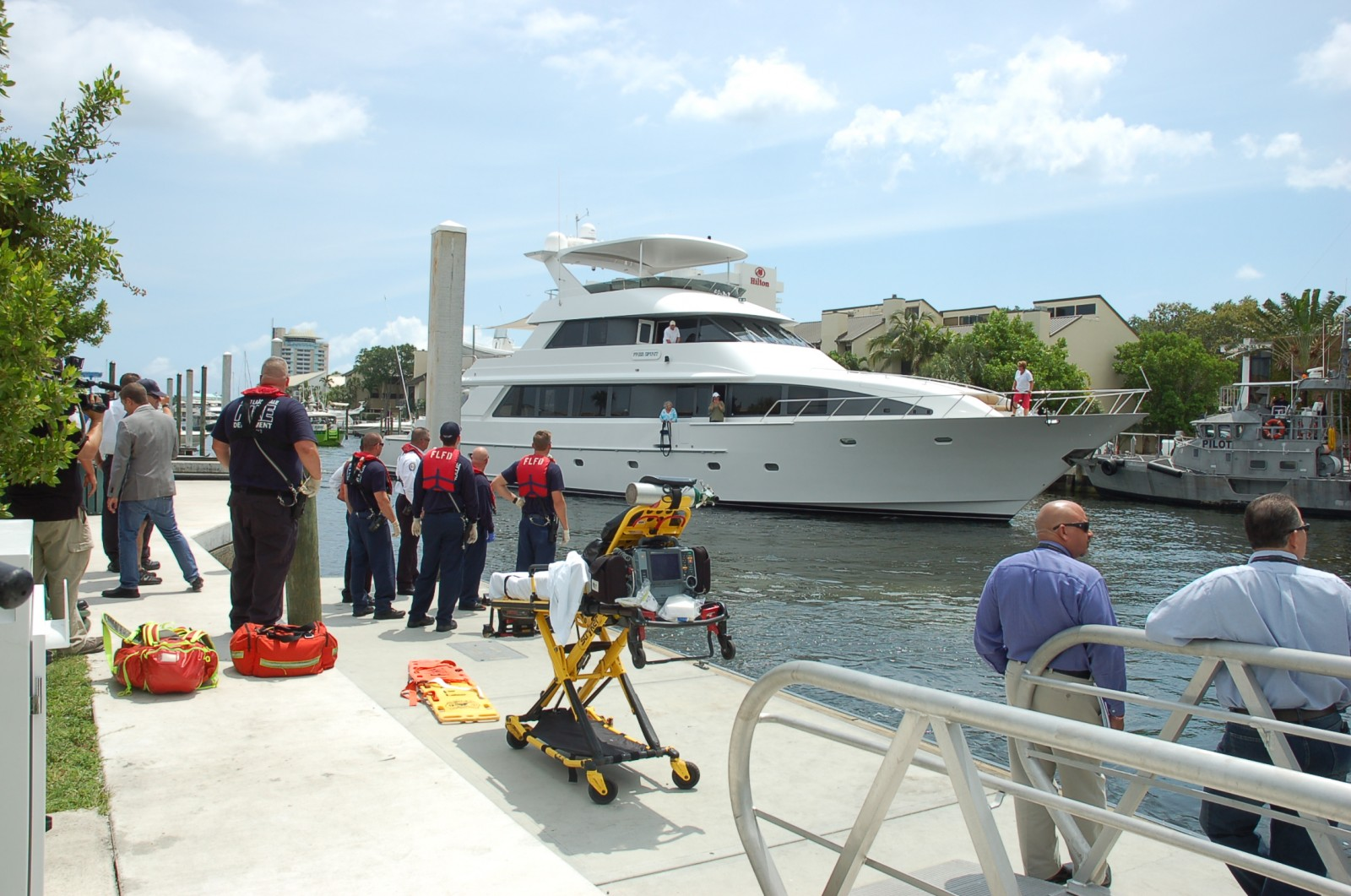 Capt. J.R. Klassen steers M/Y Free Spirit, a 105-foot Northstar, into the public boat in Ft. Lauderdale after rescuing three survivors of a small plane crash this afternoon. PHOTO BY DORIE COX