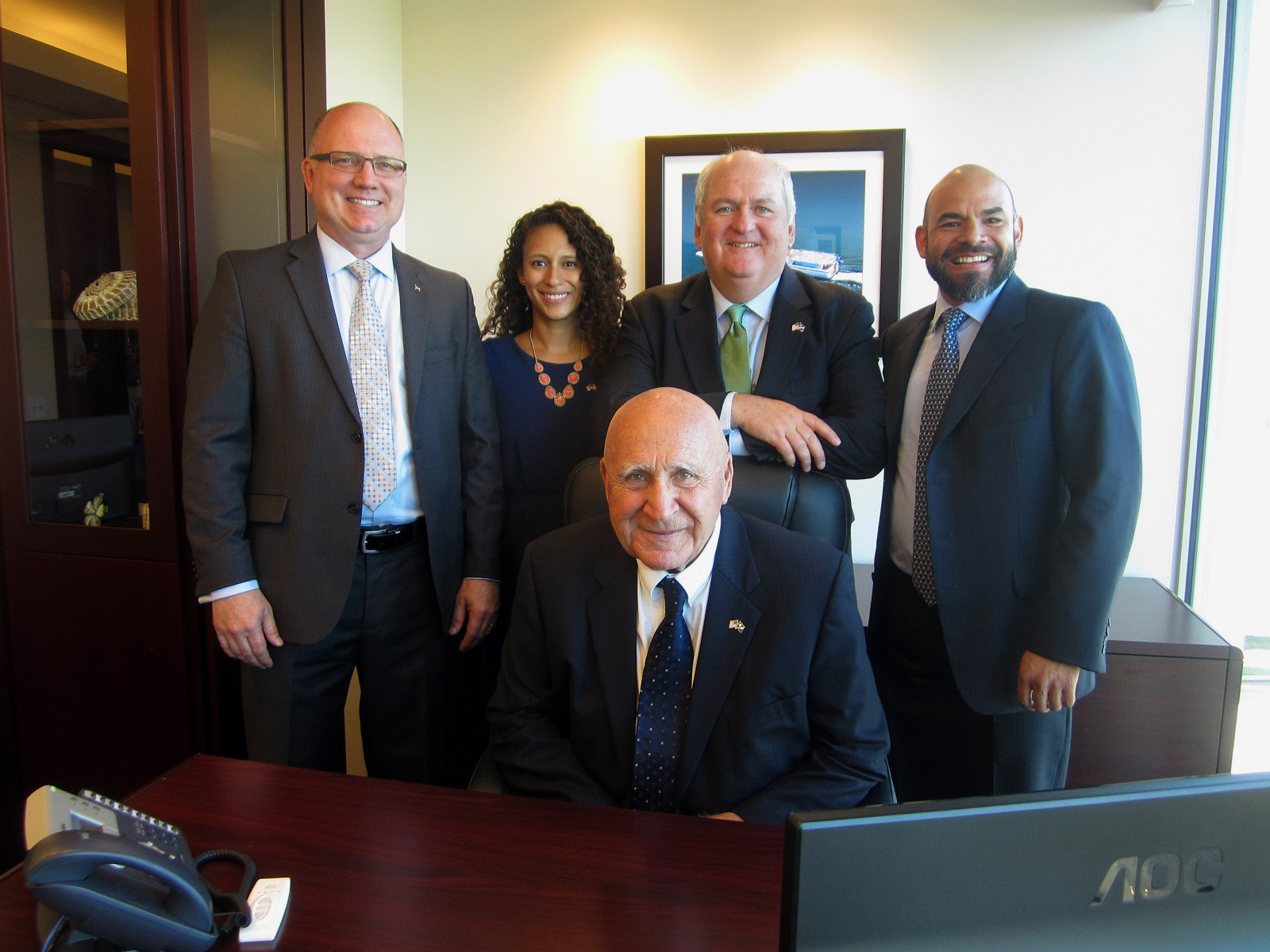 "From left, Vice President of Manning and Training Capt. John Hafner, Business Development Manager for the yachts division Ionna Hernandez, Managing Partner F.A. ""Tony"" Guida (sitting), Managing Partner/President William Gallagher, and General Manager Diego Ramirez. PHOTO/LUCY REED"
