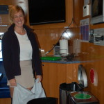 Chief Stew McKenzie Munroe tidies up the crew mess after lunch aboard M/Y Natita.  PHOTO/LUCY REED