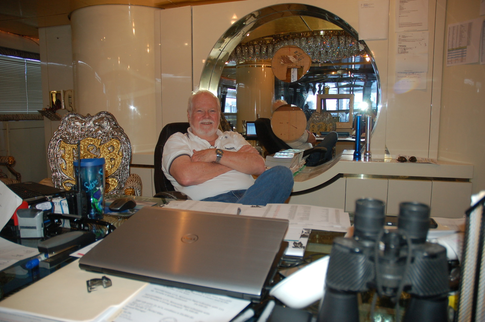 Capt. Rusty Allen, fleet manager for vessels in the Natita fleet, has set up his office in the main dining room of M/Y Mystere, a yacht built in 1987 by Lloyds Ship and awaiting a refit. PHOTO/LUCY REED