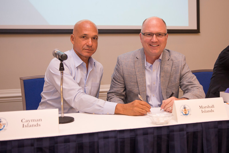 A. Joel Walton, CEO of Cayman Registry (left), and Capt. John K. Hafner, vice president, seafarer manning and training of the Republic of the Marshall Islands (RMI) Registry.